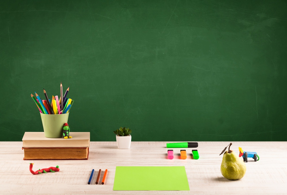 Back to school concepty with clear blackboard background, desk, items
