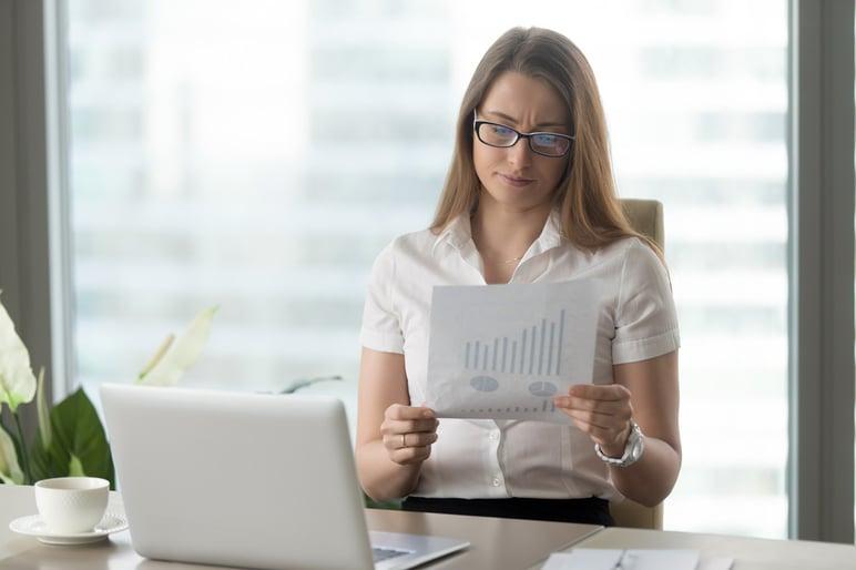 woman-analyzing-downward-financial-indicators